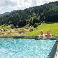 Go for a swim amid the mountain views © Hotel Bacher